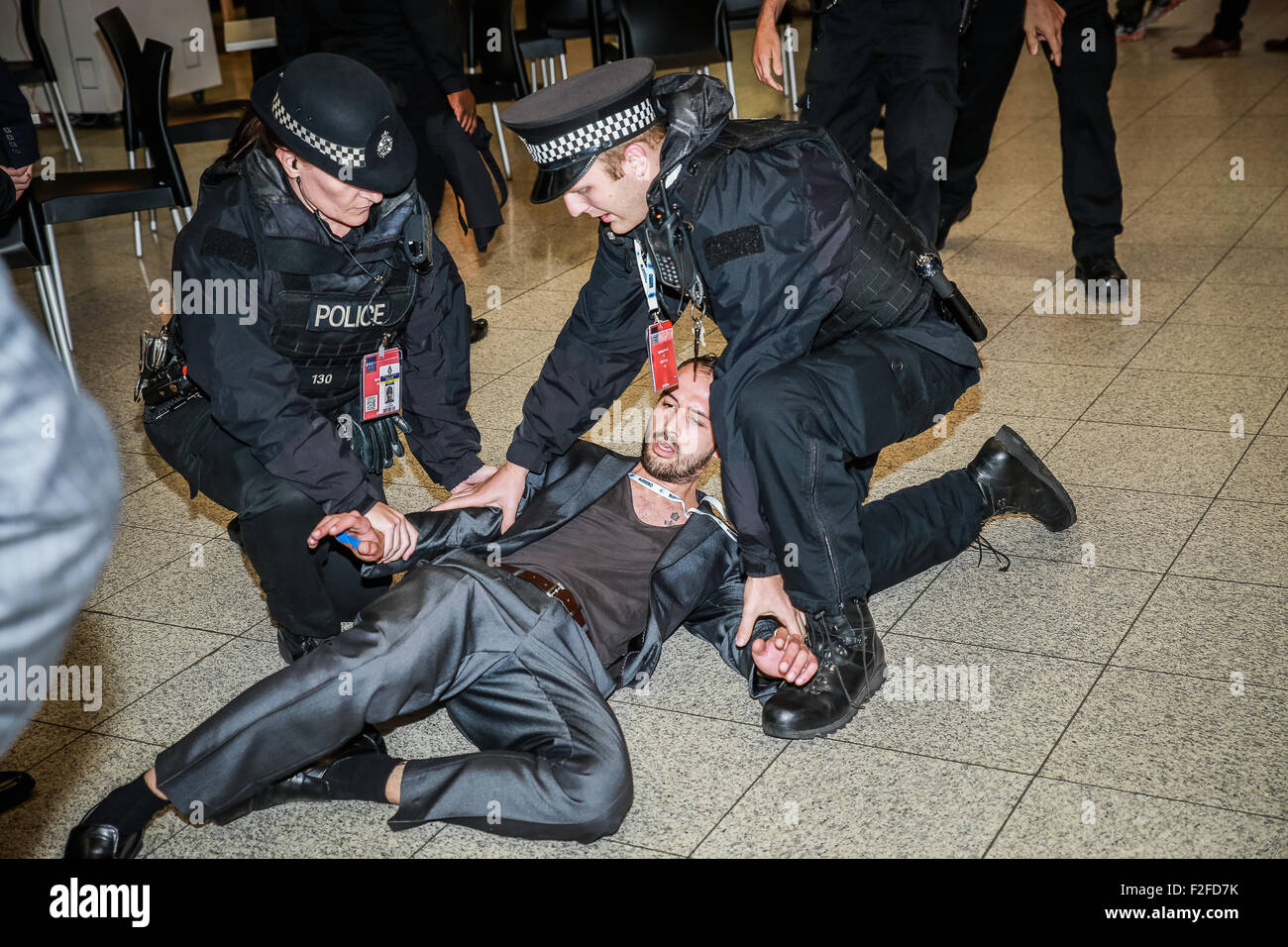DSEI, EXCEL, London, UK; 16th September 2015; Protestor entered arms fair to take pictures of military personnel's Stock Photo