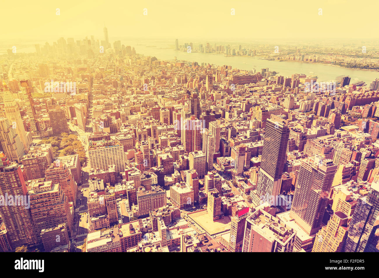 Vintage filtered picture of sunset over Manhattan, New York City downtown, USA. - Stock Image