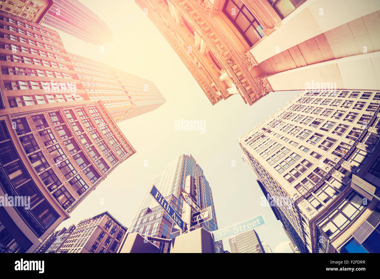 Vintage filtered fisheye picture of Manhattan, looking up at sky, New York City, USA. - Stock Image