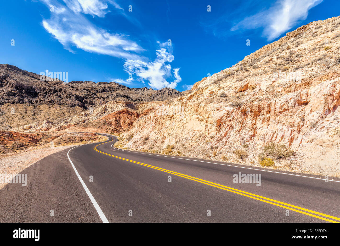 Country curved road in USA, travel concept. - Stock Image