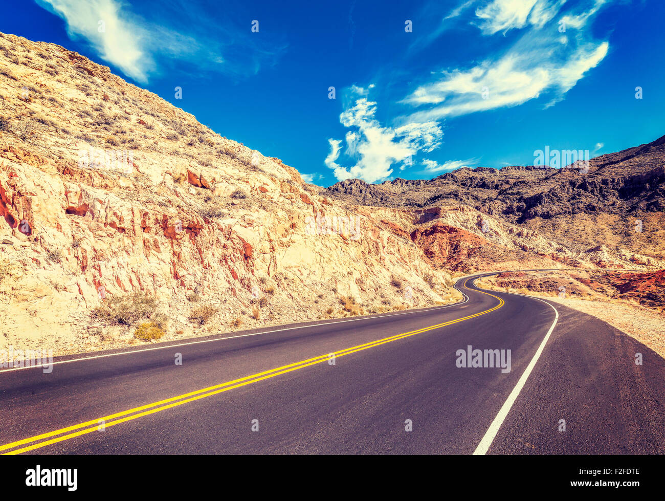 Vintage stylized country road in USA, travel concept. - Stock Image