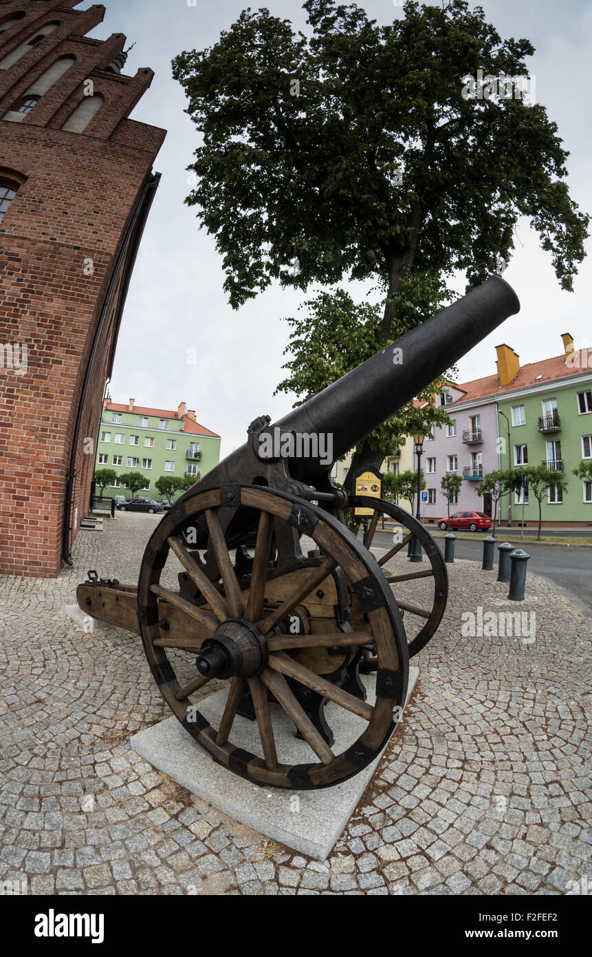 One of two French cannons near 15th century town hall, Morąg, northern Poland - Stock Image