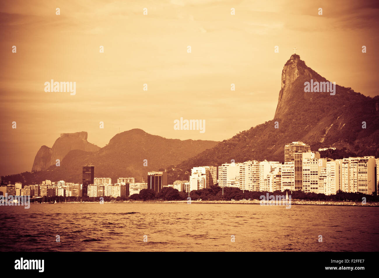 Sepia view of Rio de Janeiro city waterfront viewed from Guanabara Bay with Corcovado mountain in background, Brazil. Stock Photo