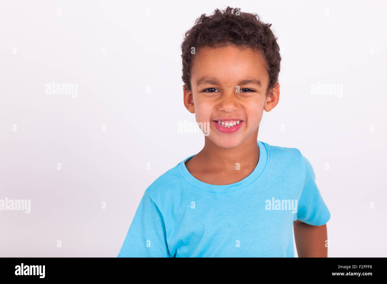 Portrait of a cute little African American boy smiling - Stock Image