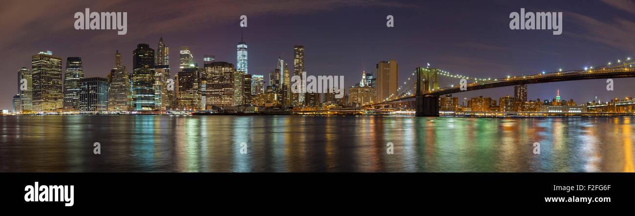 Manhattan skyline at night, New York City panoramic picture, USA. - Stock Image
