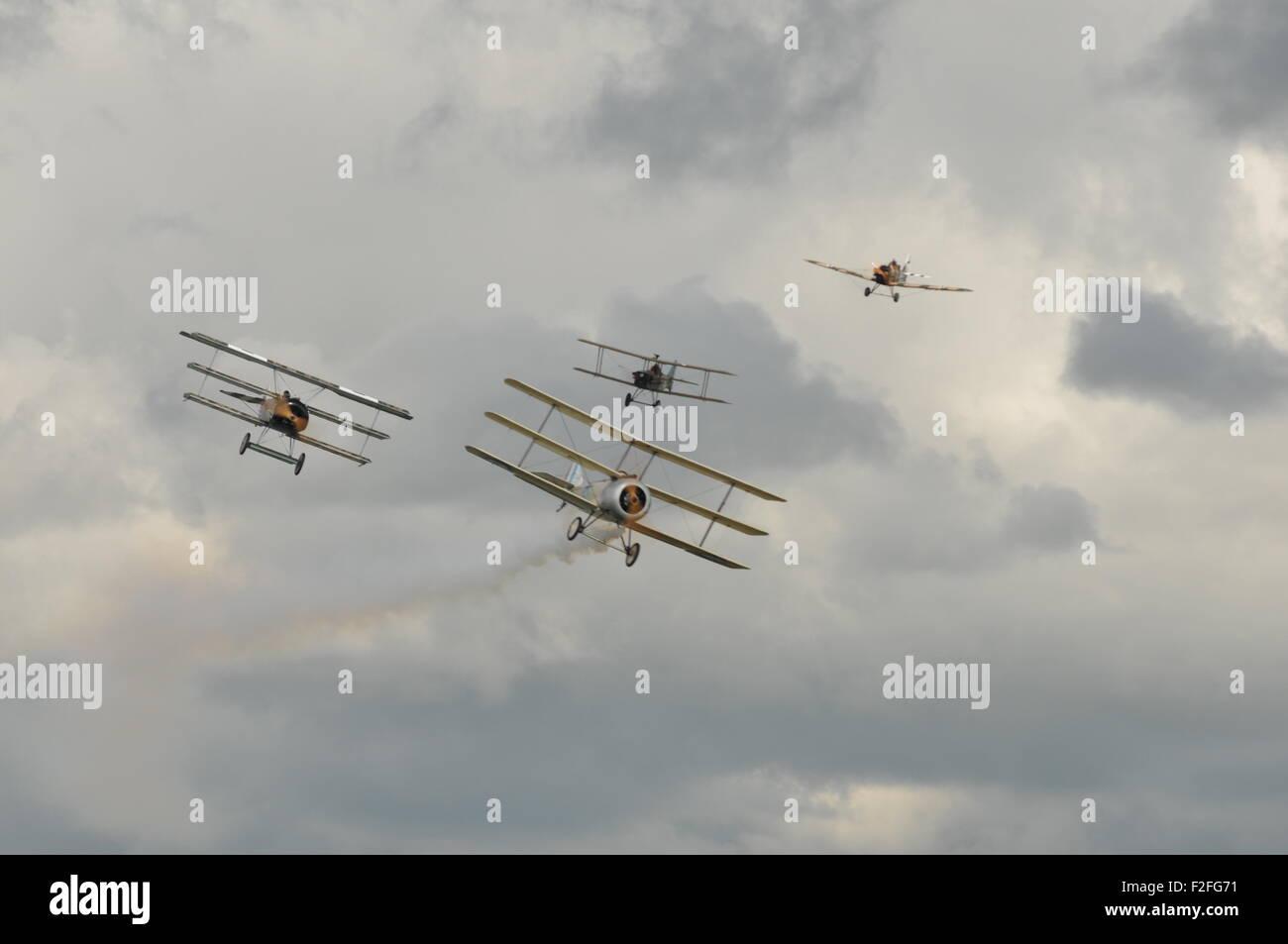 Great war display team 4 aircraft flying towards camera, 2 triplanes, 2 biplanes, 1 monoplane - Stock Image