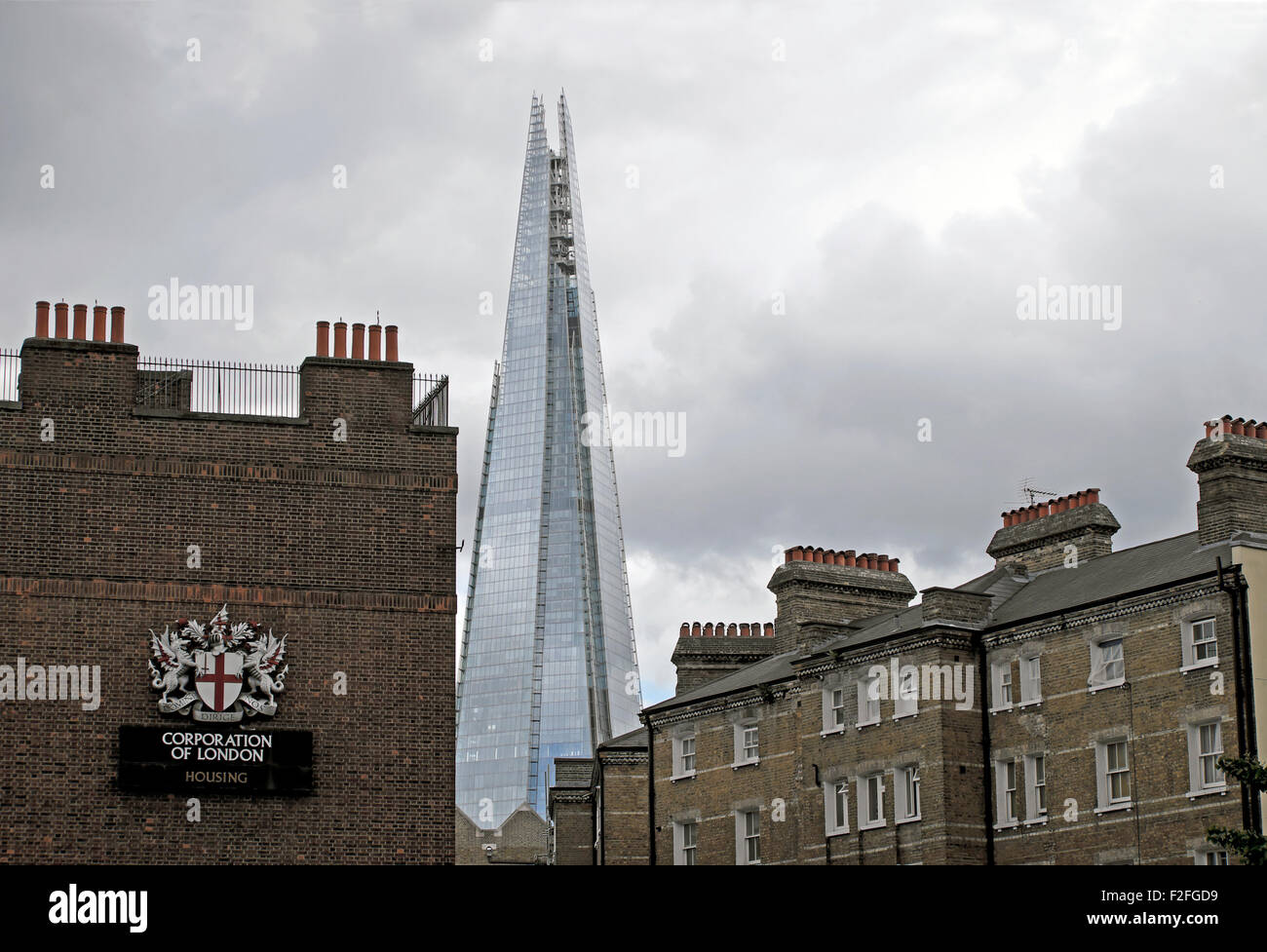 The modern Shard building viewed from a Corporation of London housing estate old new architecture in South London, - Stock Image