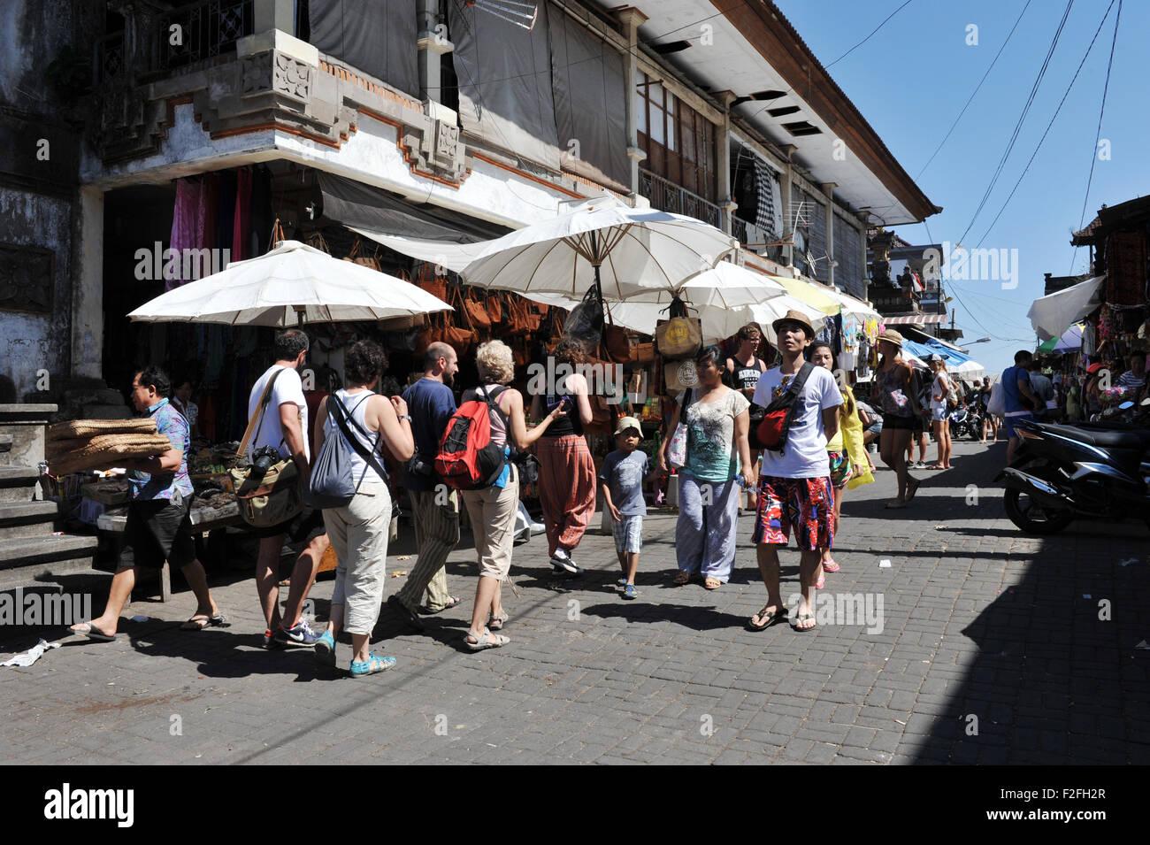 tourist on the street at Ubud Market - Stock Image