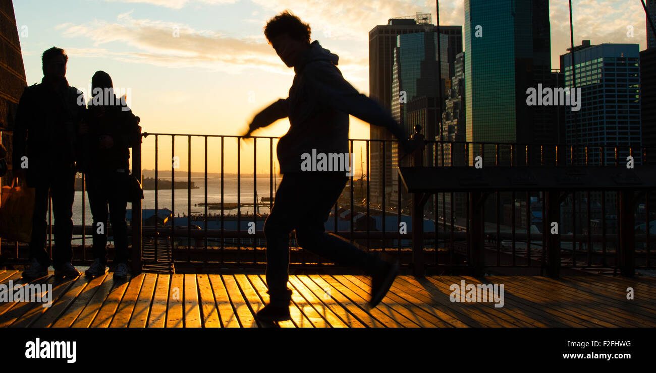 Man dancing on terrace at sunset, Midtown, Manhattan, New York City, New York State, USA - Stock Image