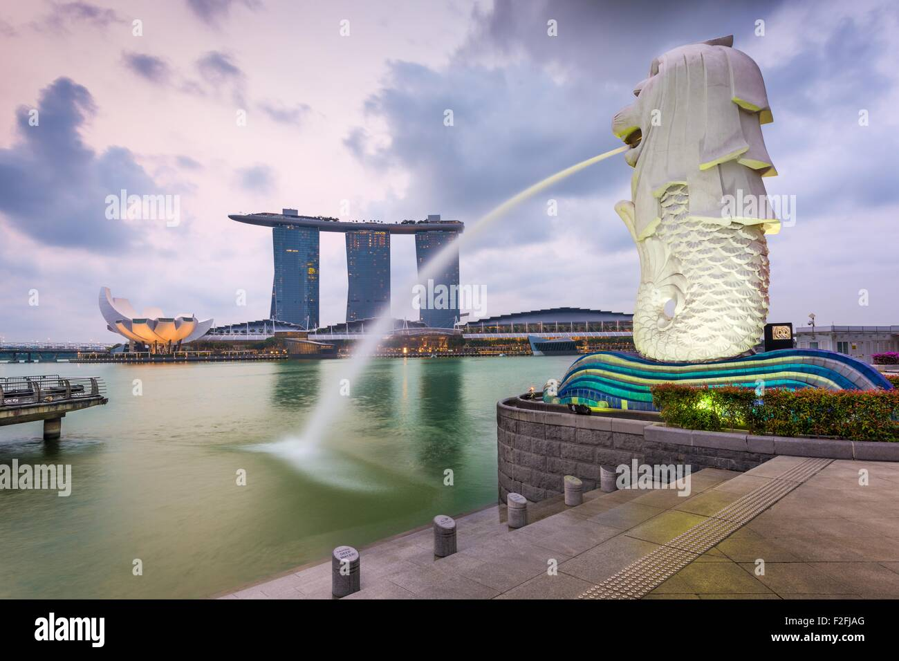 The Merlion fountain at Marina Bay. The merlion is a marketing icon used as a mascot and national personification - Stock Image
