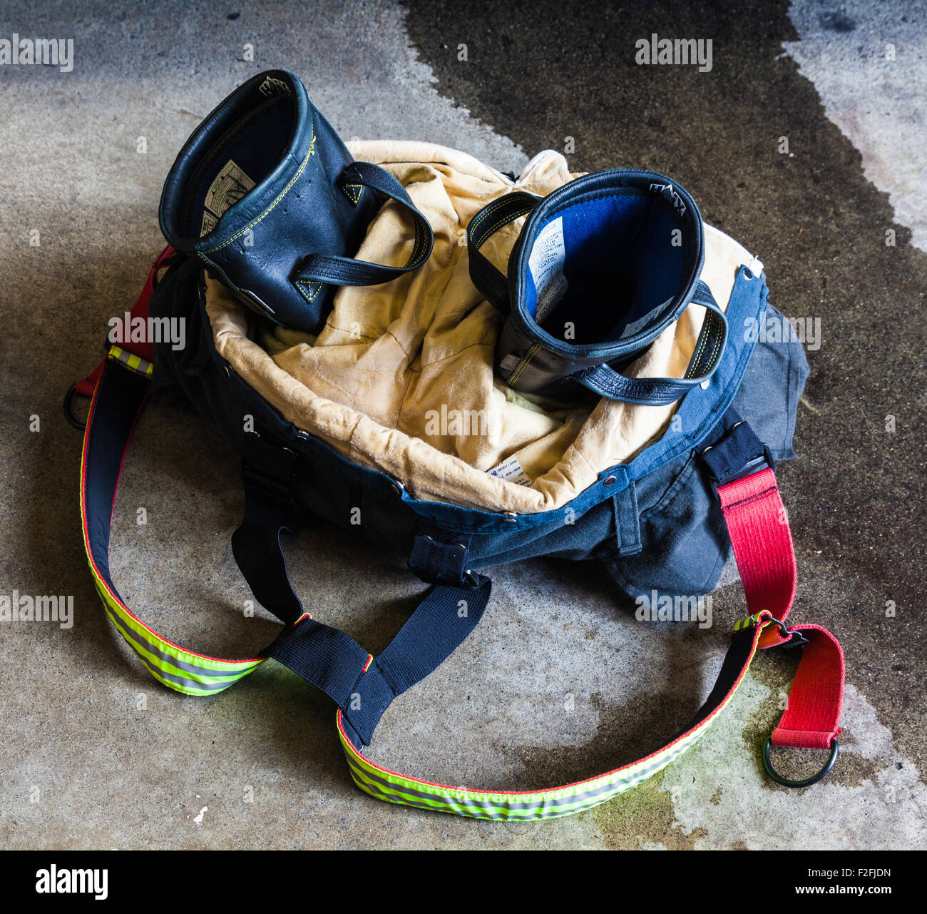 Detail of a fireman's pants and boots in readiness for an emergency call from a Vancouver Fire Hall - Stock Image