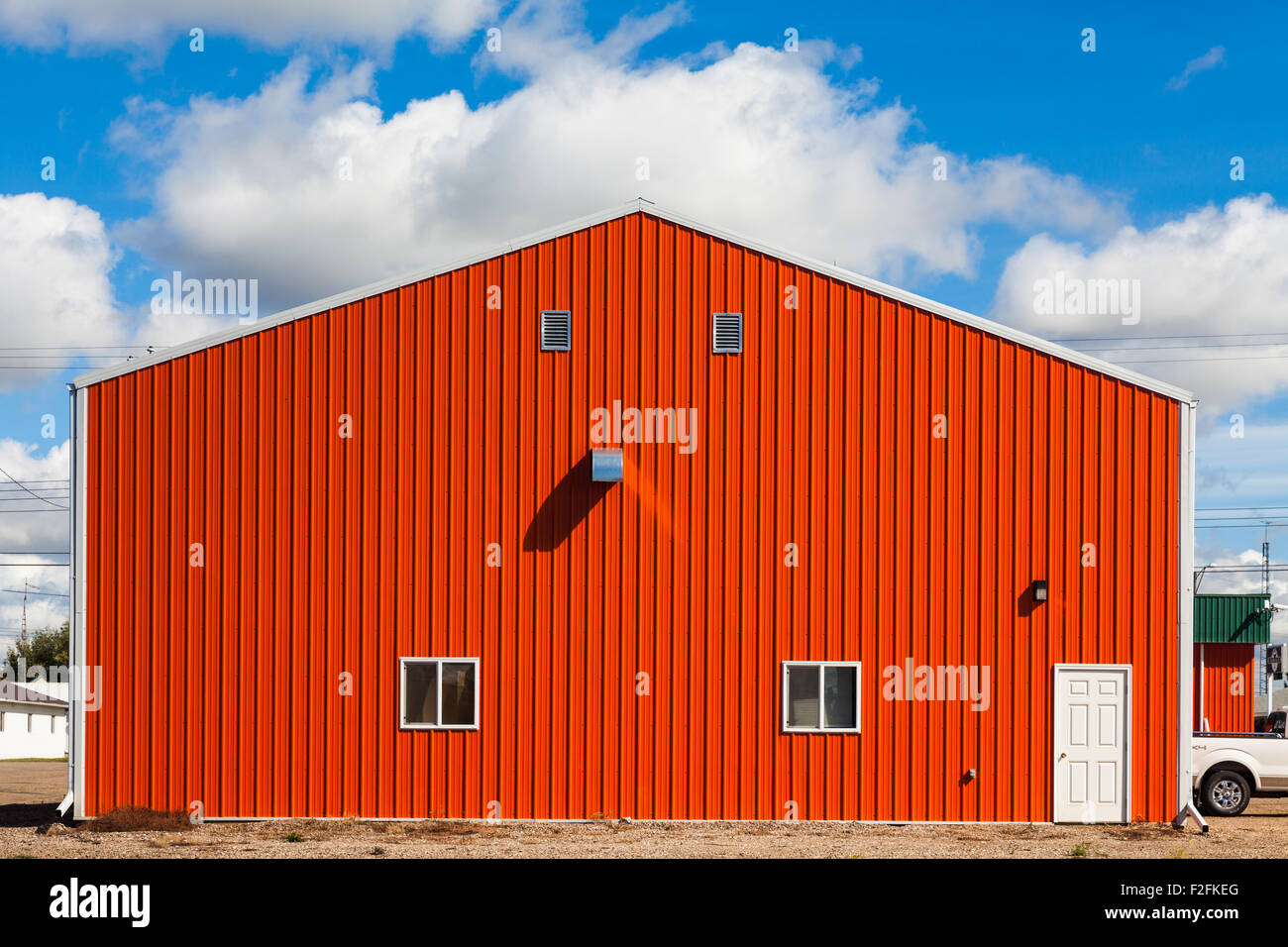 Orange agricultural building in the town of Castor, Alberta, Canada - Stock Image