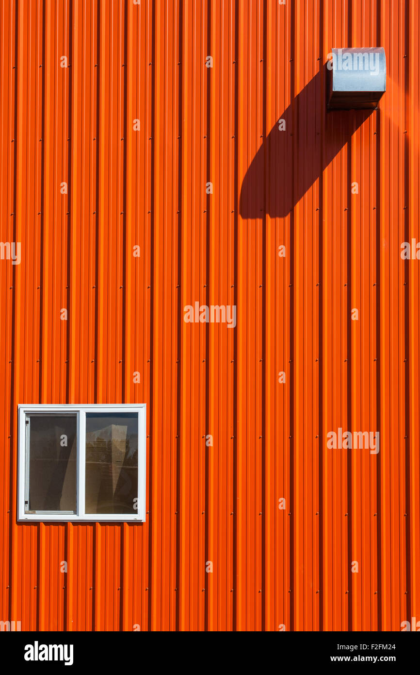 Abstract image of an orange agricultural building in Castor, Alberta - Stock Image