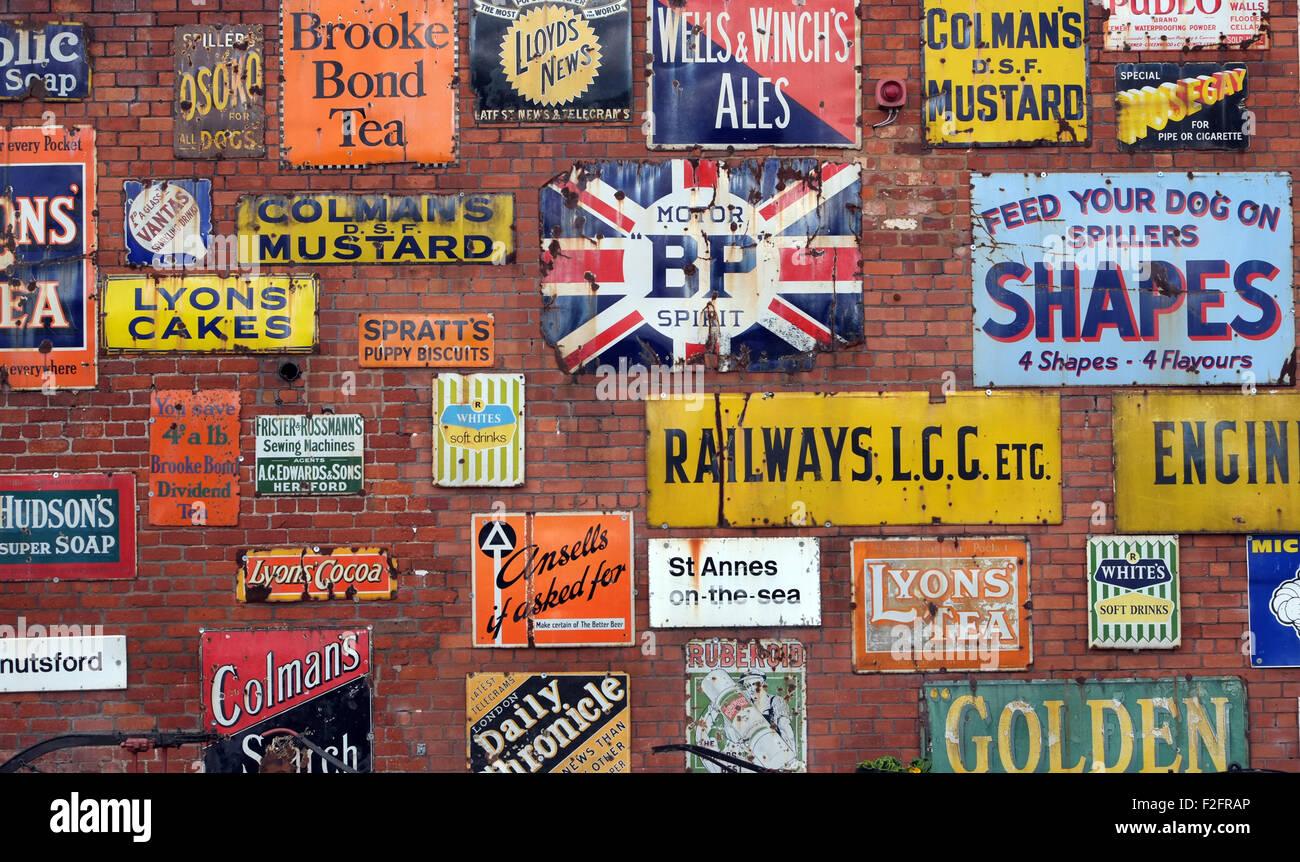 Vintage enamel advertising signs at Bygone Times antiques centre, Eccleston, Chorley, , Lancashire, England UK - Stock Image