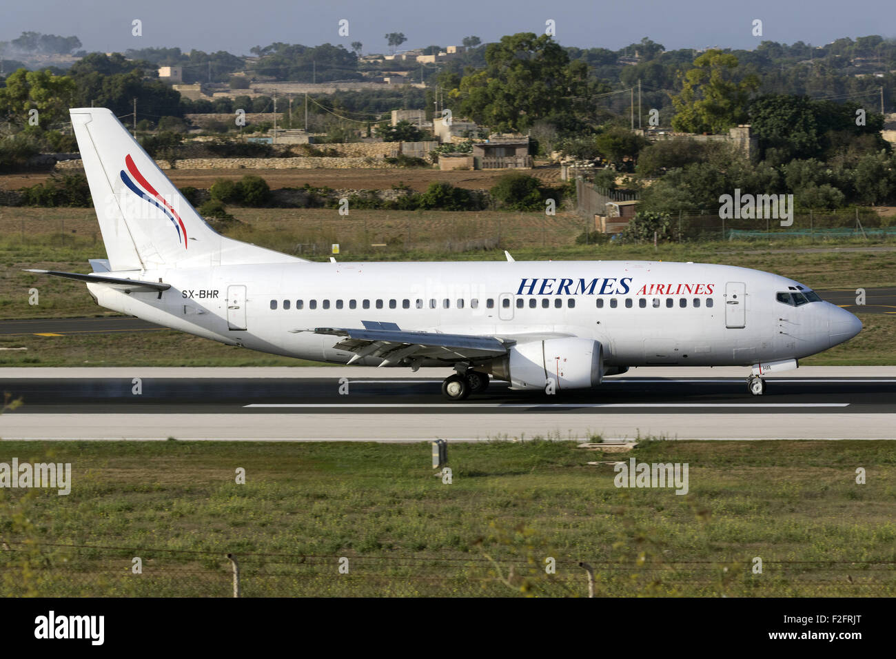 Hermes Airlines Boeing 737-5L9 landing runway 31, operating for Air Mediterranee. - Stock Image
