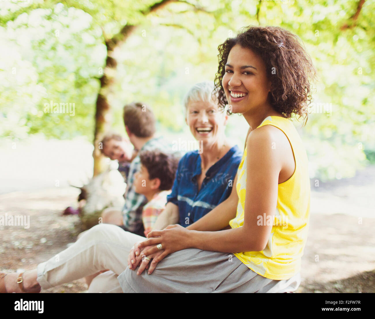 Portrait laughing multi-generation family in woods - Stock Image