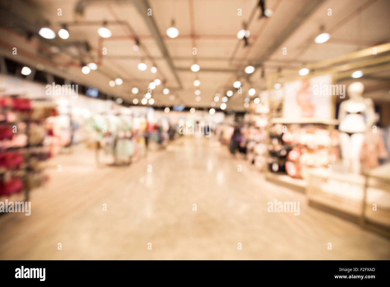 out of focus shot from the inside of a department store, showing the womens clothing department Stock Photo