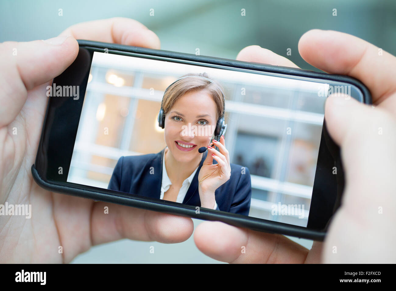 Businesswoman chatting with smart phone - Stock Image