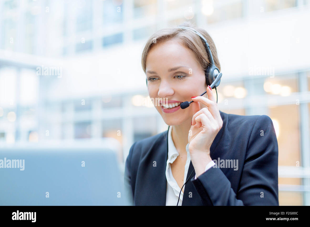 Operator talking on microphone Stock Photo