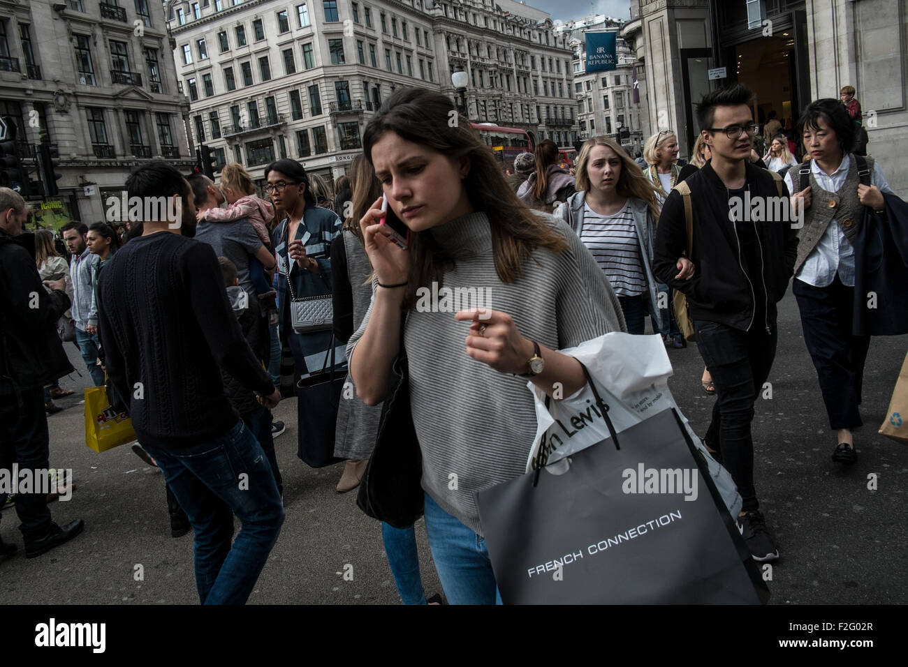 Shoppers on Regent Street, one of the main shopping streets in the West End of London. UK - Stock Image