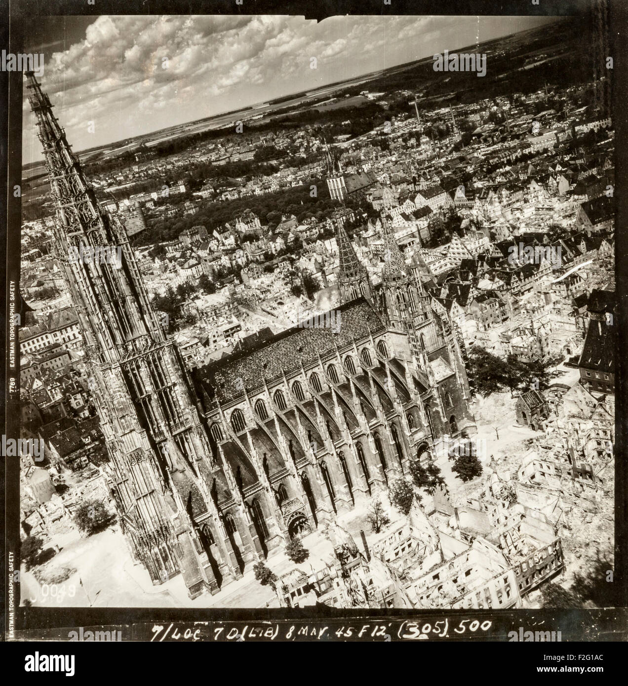 Aerial photograph of the German city of Ulm taken after the devastating air raid of December 1944, showing the huge destruction caused by Allied bombing yet leaving the church, Ulm Minster, largely intact. Most of the city's medieval centre was destroyed by the bombing. The church, also known as Ulm Cathedral, Ulm Münster or Ulmer Münster has the tallest spire of any church in the world (161.5m). The church was built between approximately 1400 and 1540, though the steeples were not completed until 1890. Stock Photo