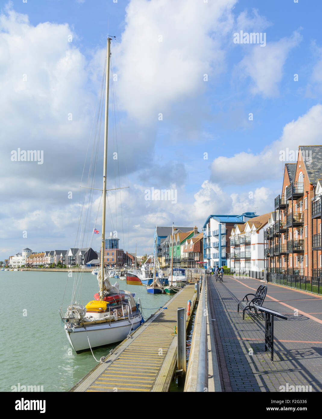 Riverside housing and towpath along the River Arun, Littlehampton, West Sussex, England, UK. Stock Photo