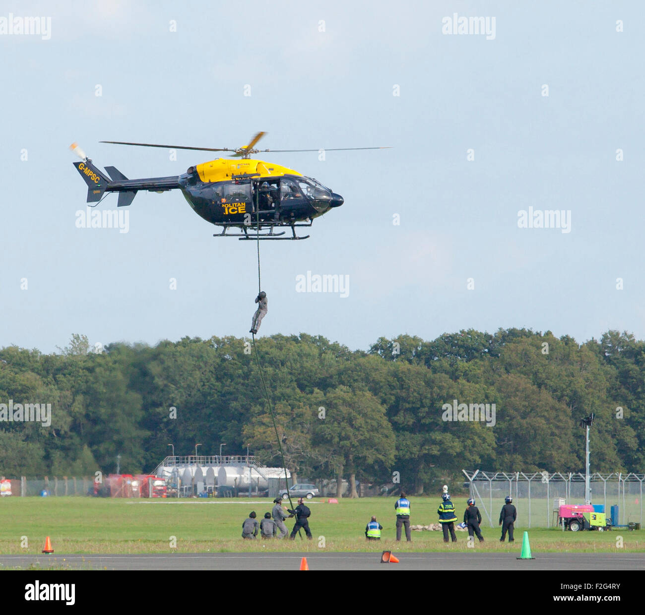 Dunsfold Aerodrome, Surrey, England, UK. 17th September 2015. Metropolitan Police helicopter, with personnel practicing - Stock Image