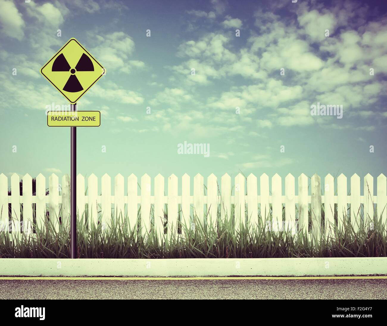nuclear radiation warning symbol with blue sky Stock Photo