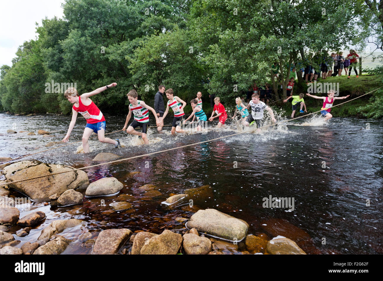 Fording a stream on the the junior fell race, Muker Show, North Yorkshire, 2015 - Stock Image