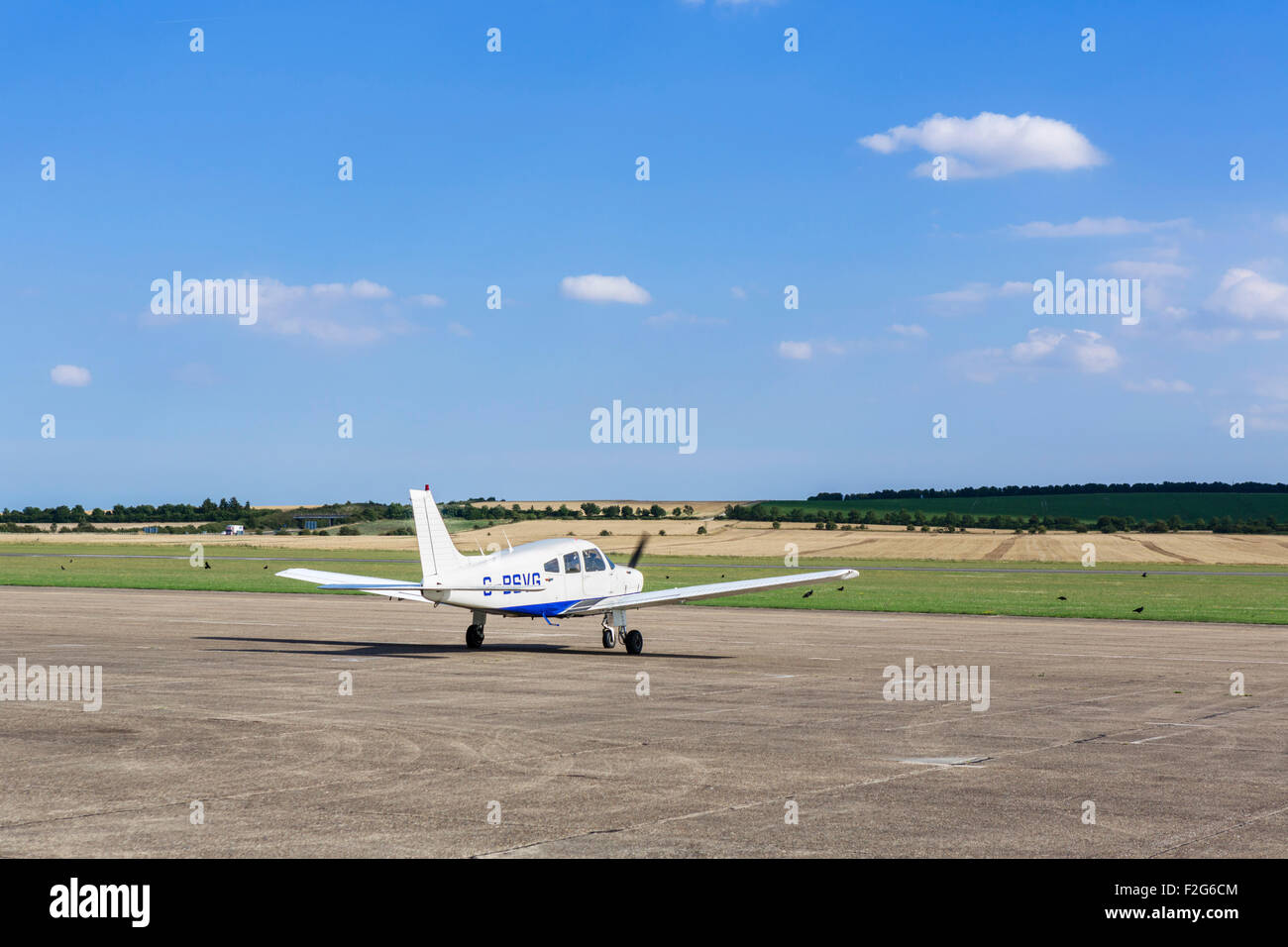 Piper PA-28-161 Cherokee Warrior II waiting for take-off clearance at Duxford aerodrome, Cambridgeshire, England, - Stock Image
