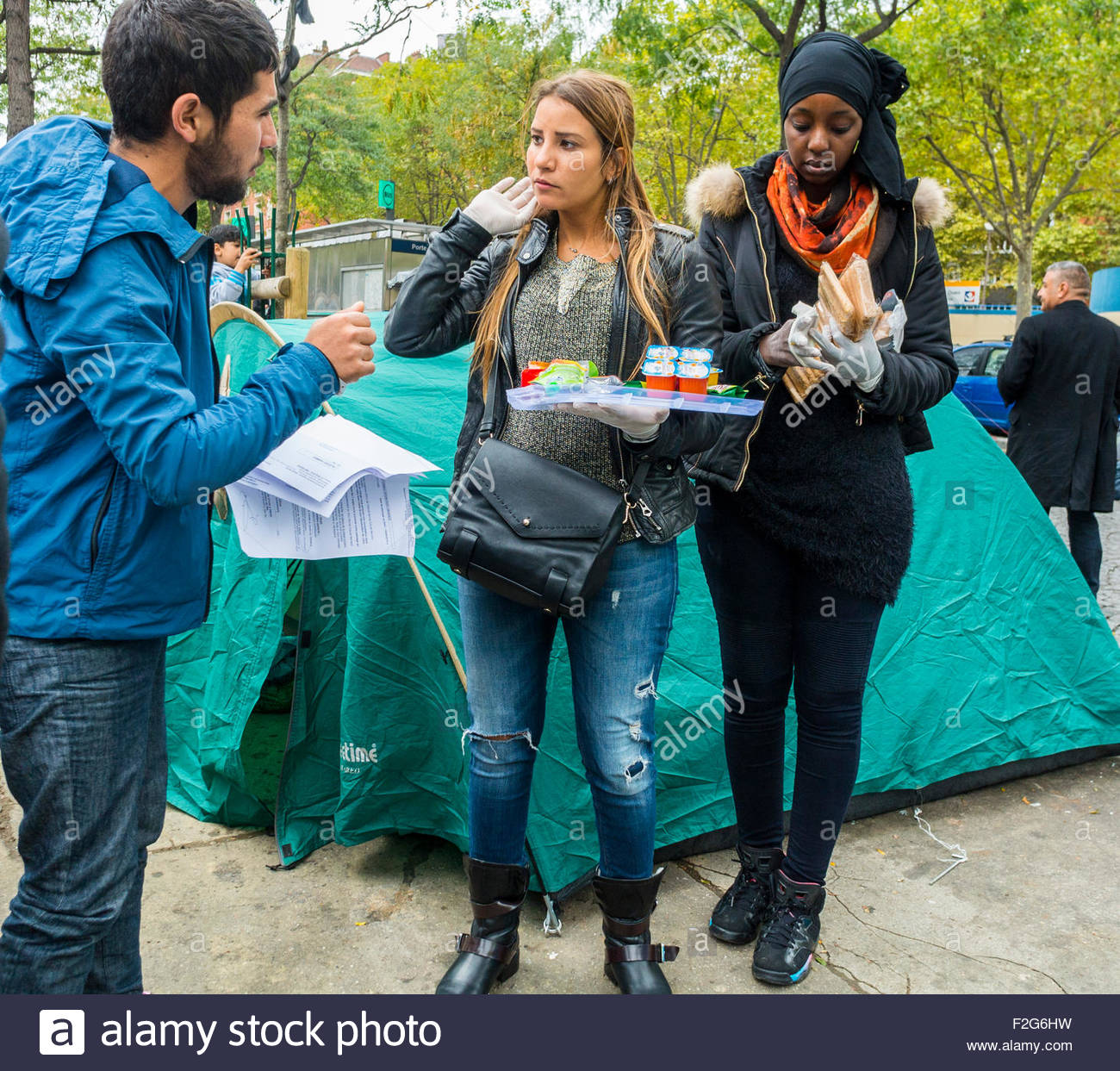 Paris, France. Group of French Volunteers serving food in Camp of Syrian Refugees, Migrants, at 'Port de Saint - Stock Image