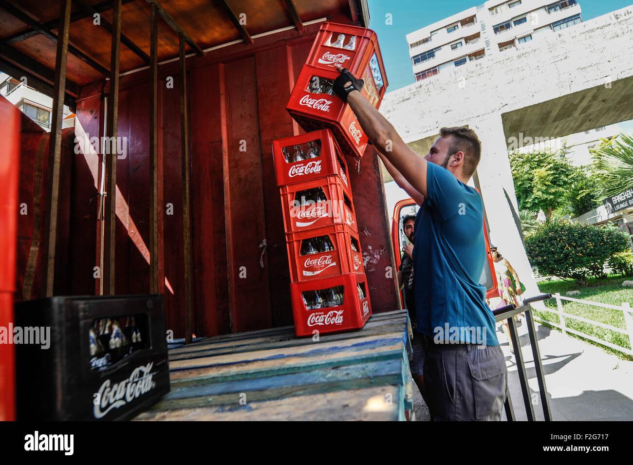 the delivery of Coca Cola-la entrega de Coca Cola - Stock Image