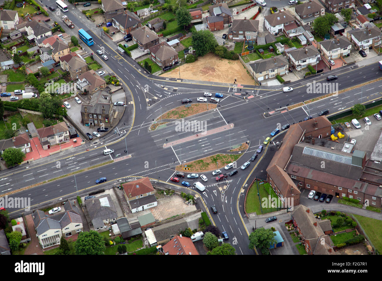 aerial view of a roundabout junction on the A647 Bradford Road between Bradford and Leeds, Yorkshire, UKfrom - Stock Image
