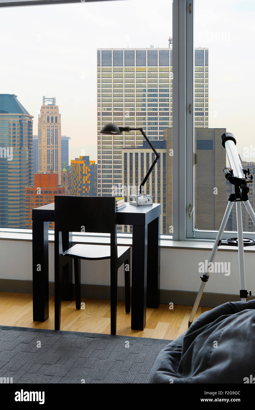 Home office with city view - Stock Image