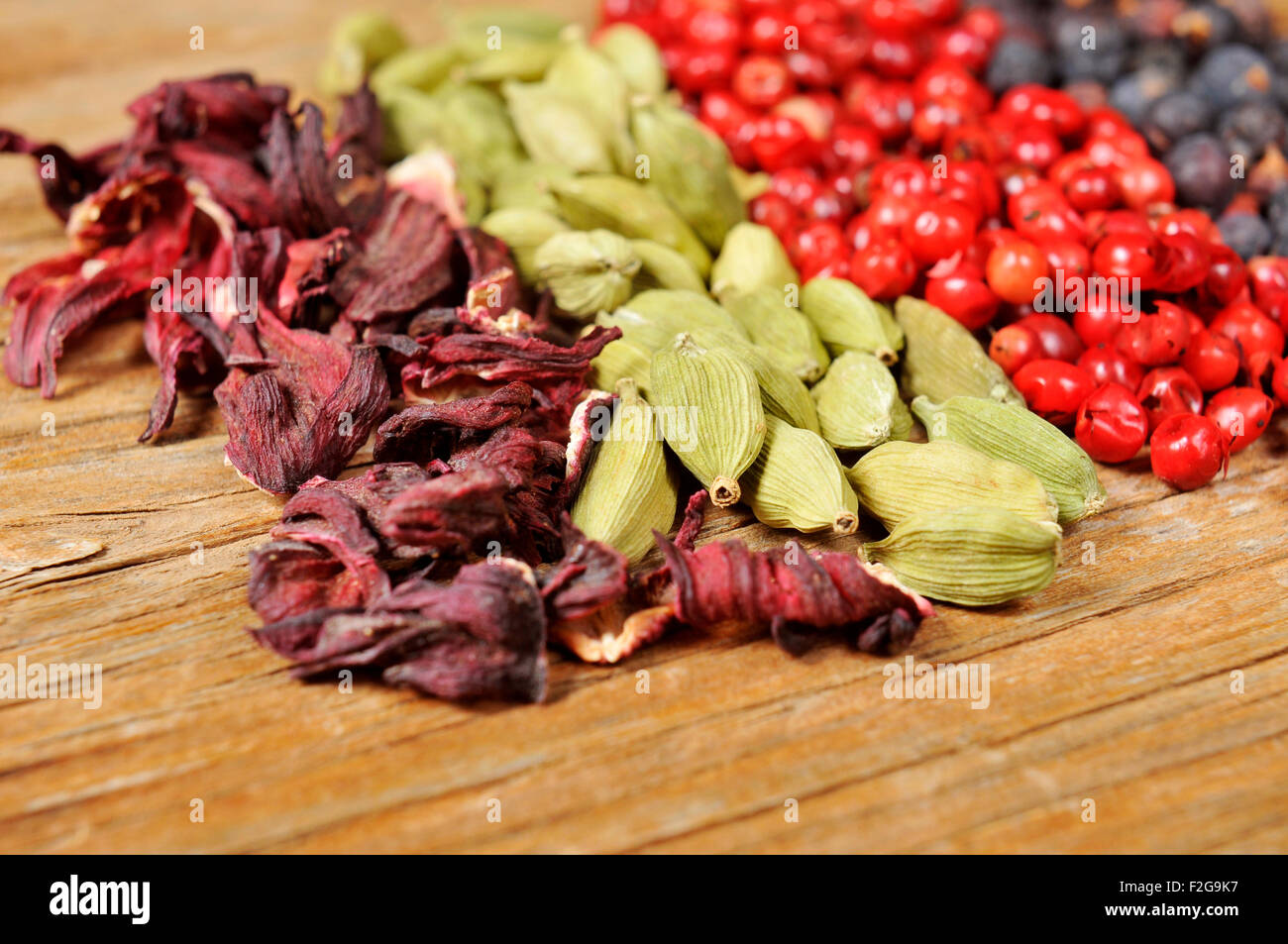 Dried hibiscus flowers stock photos dried hibiscus flowers stock a pile of dried hibiscus flowers green cardamom pink peppercorns and juniper berries on izmirmasajfo