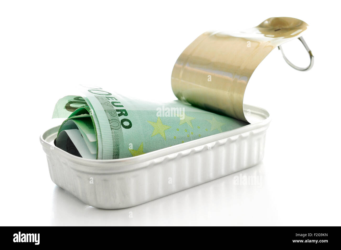 a wad of euro bills in a can on a white background - Stock Image