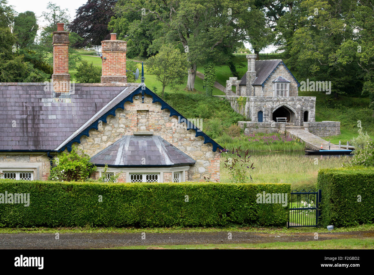 Cottage home and Boathouse on the grounds of Crom Castle, Upper Lough Erne, County Fermanagh, Northern Ireland, - Stock Image