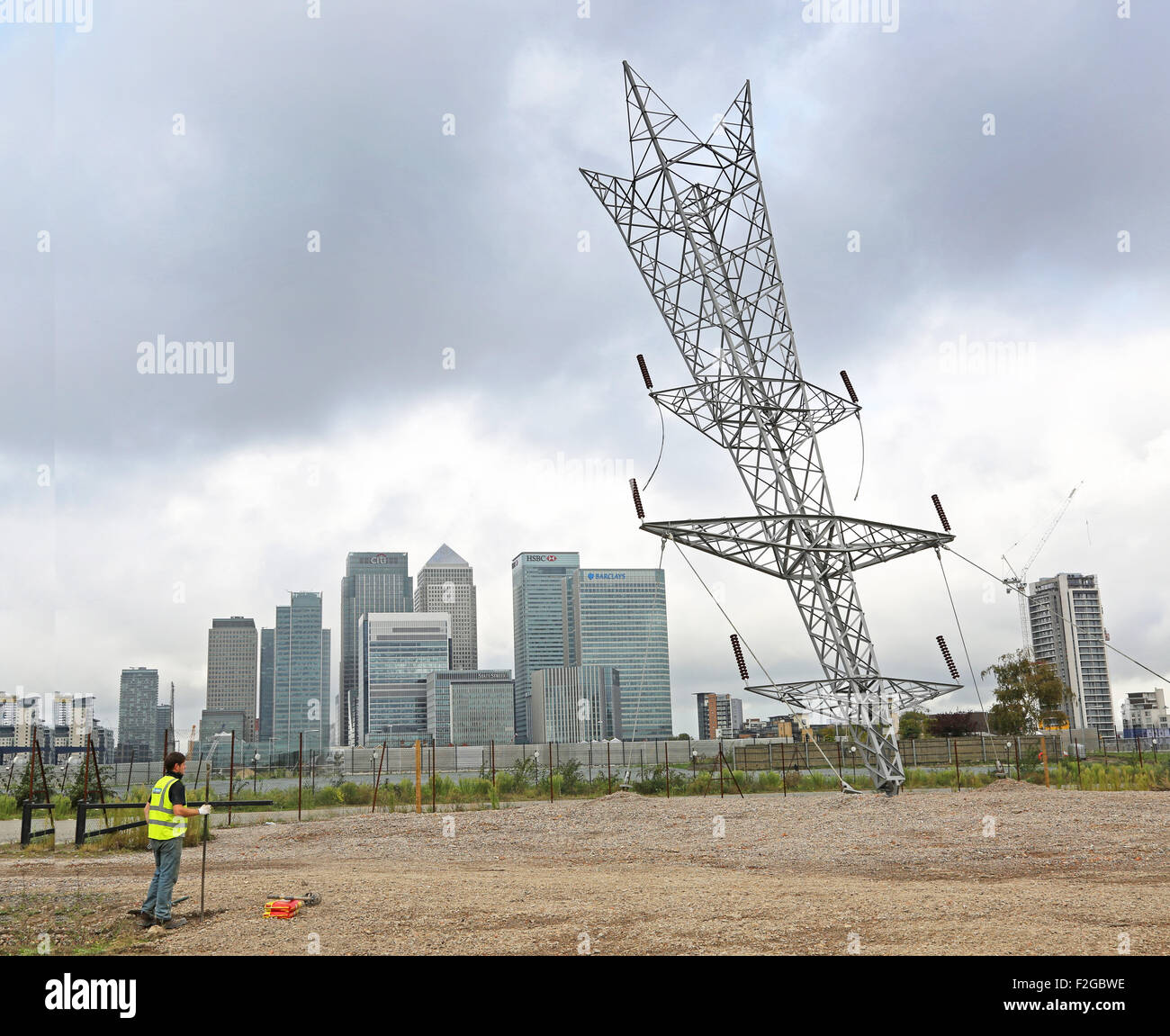 Alex Chinneck's  A Bullet From a Shooting Star, Greenwich Peninsular, London. A full size electricity pylon - Stock Image