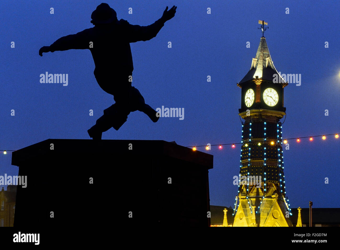 Clock Tower and the Jolly Fisherman statue at night. Skegness. Lincolnshire. England. UK - Stock Image