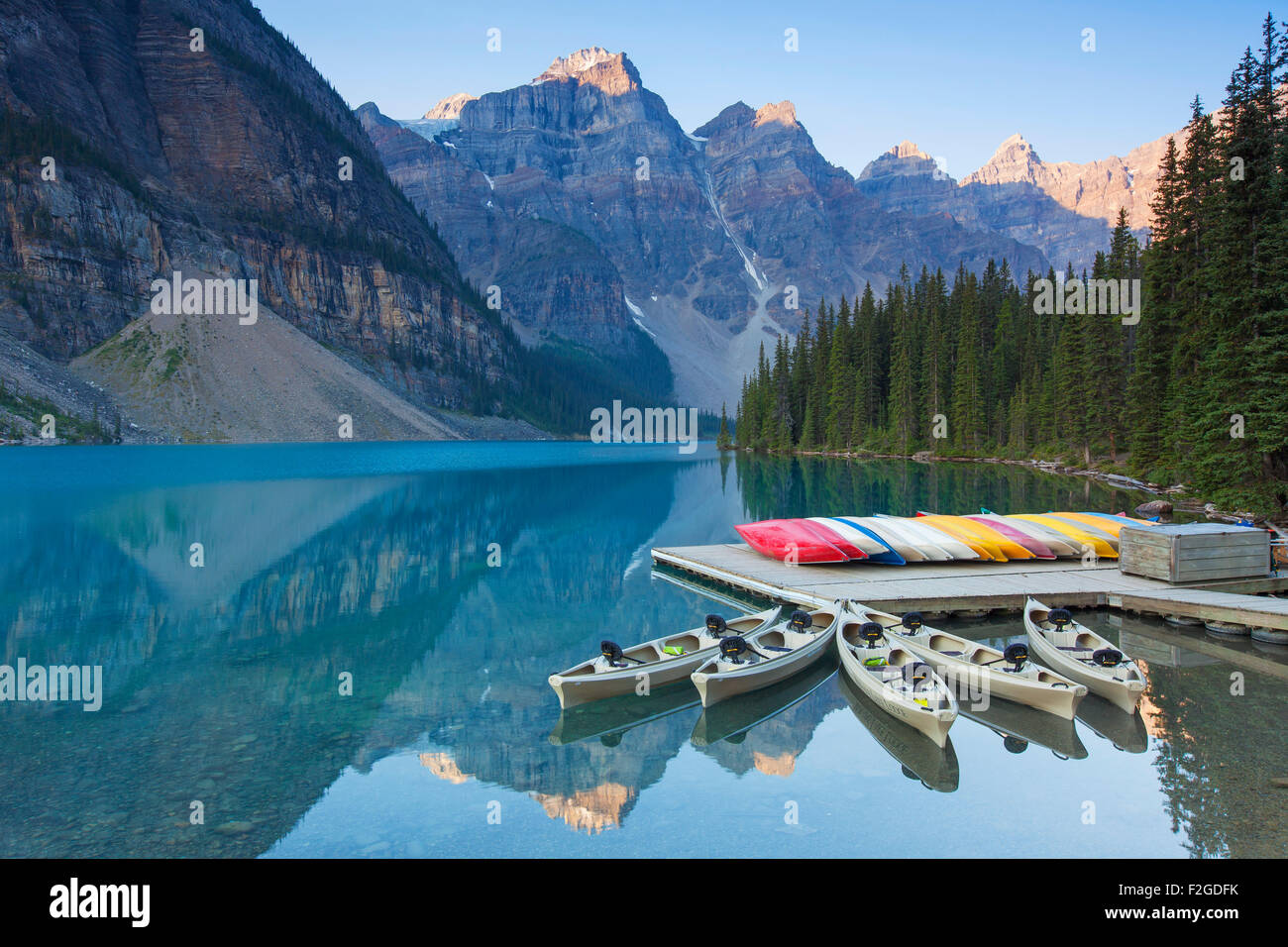 Canoes at Moraine Lake in the Valley of the Ten Peaks, Banff National Park, Alberta, Canada - Stock Image