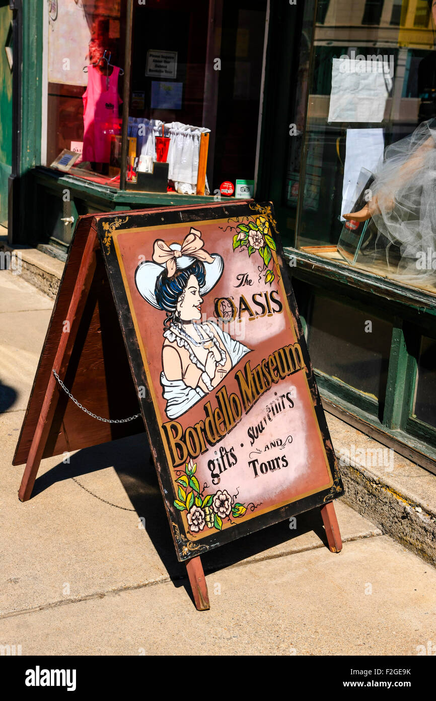 Sidewalk sign for the Oasis Bordello museum in the historic city of Wallace, set in the Silver Valley mining district - Stock Image