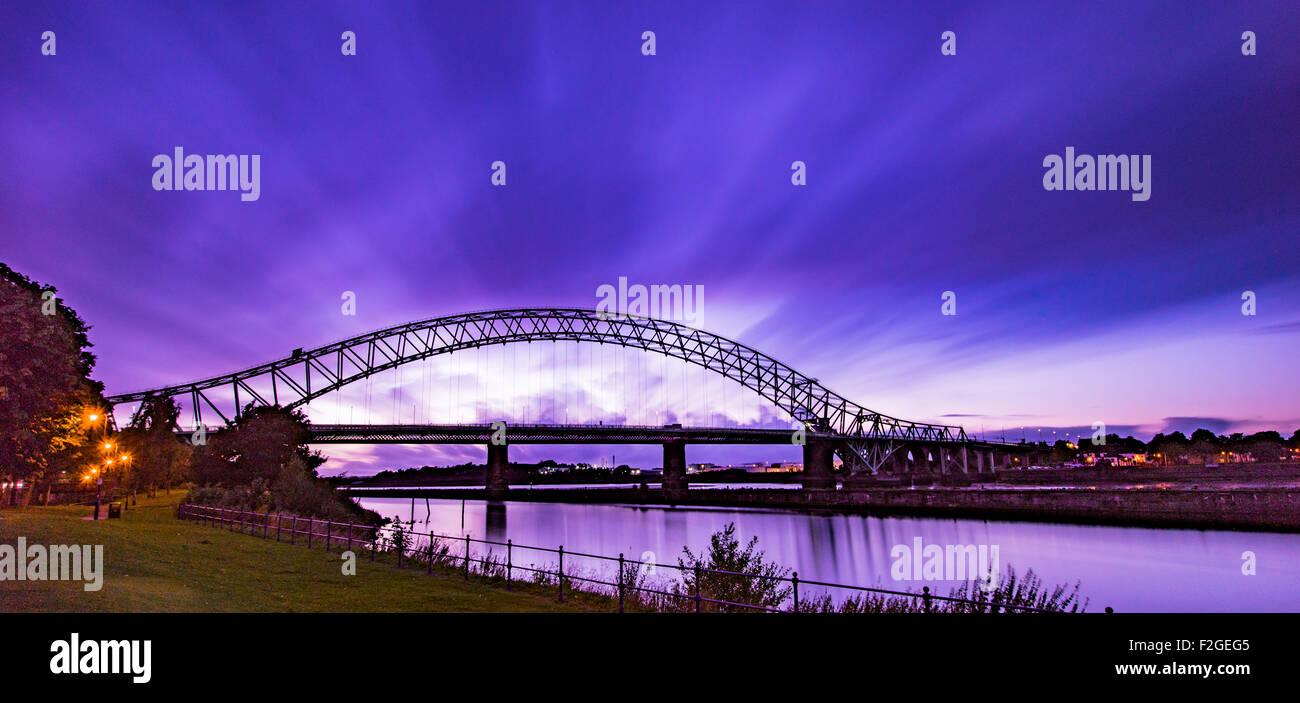 Runcorn Widnes Bridge (SIlver Jubilee Bridge) at sunset long exposure - Stock Image