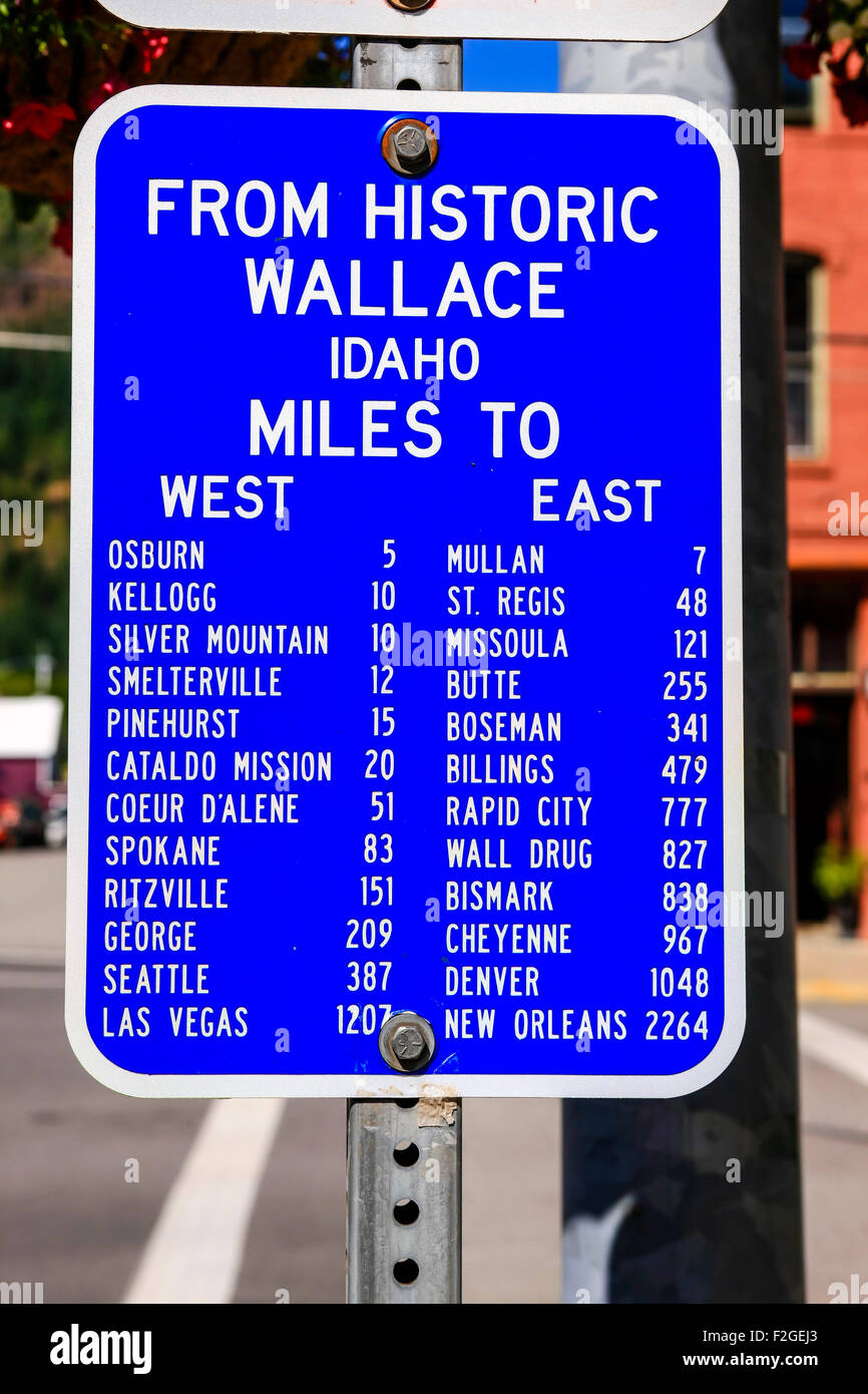 Blue and white mile marker from historic Wallace City Idaho to - Stock Image