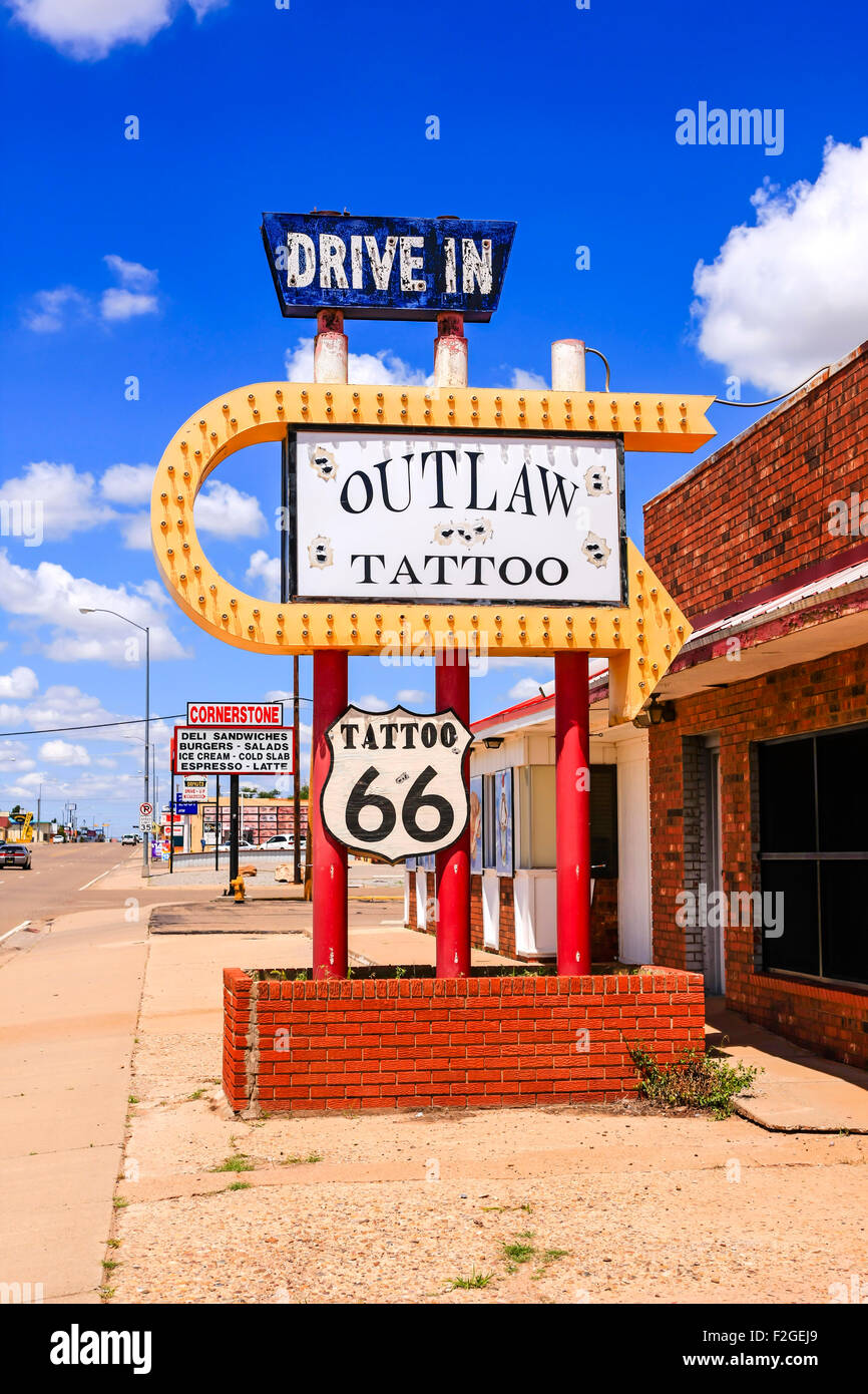 A Drive-In Outlaw Tattoo Shop sign on Route 66 in Tucumcari, New Mexico - Stock Image