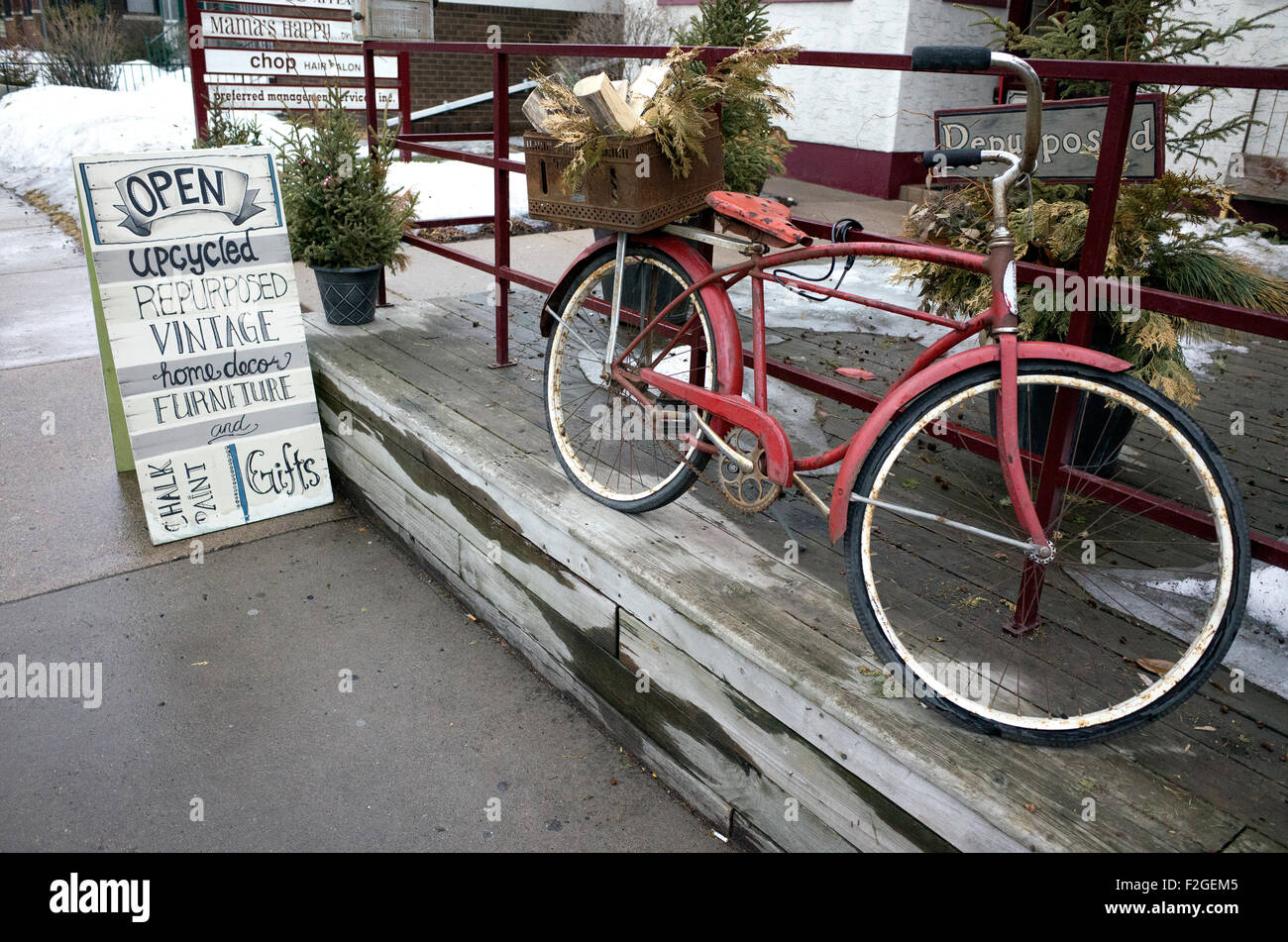 Vintage repurposed bicycle outside Mama's Happy upcycled shop on Grand Ave. St Paul Minnesota MN USA - Stock Image