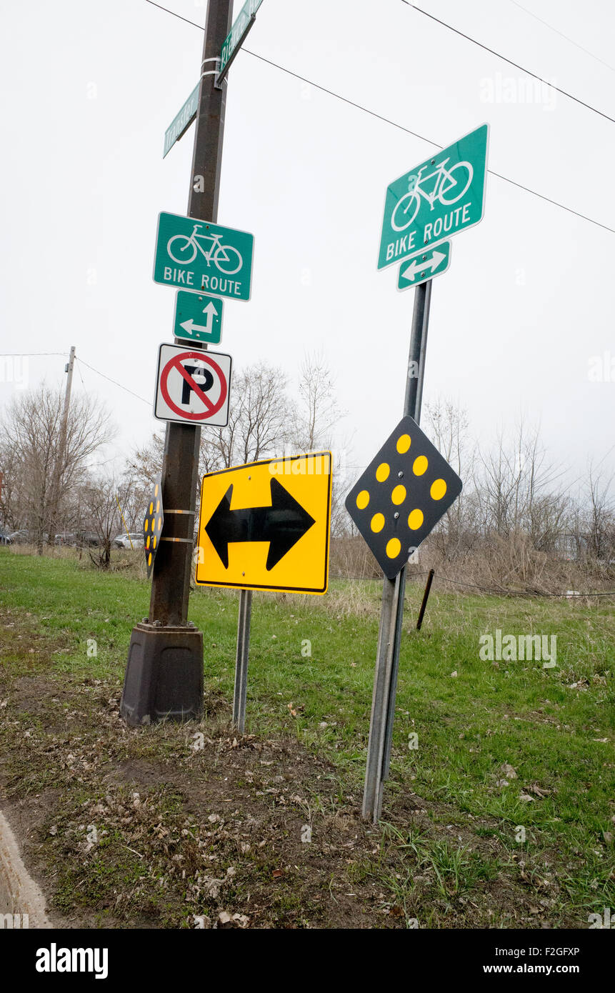 Directional signs for several city bicycle routes. St Paul Minnesota MN USA - Stock Image