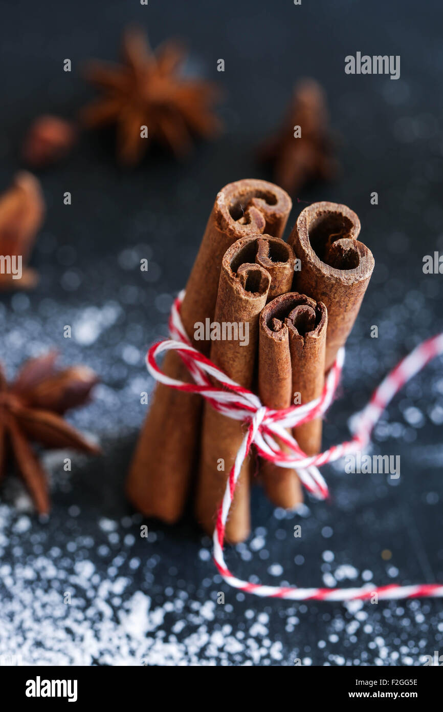 Cinnamon stick. Christmas setting. - Stock Image