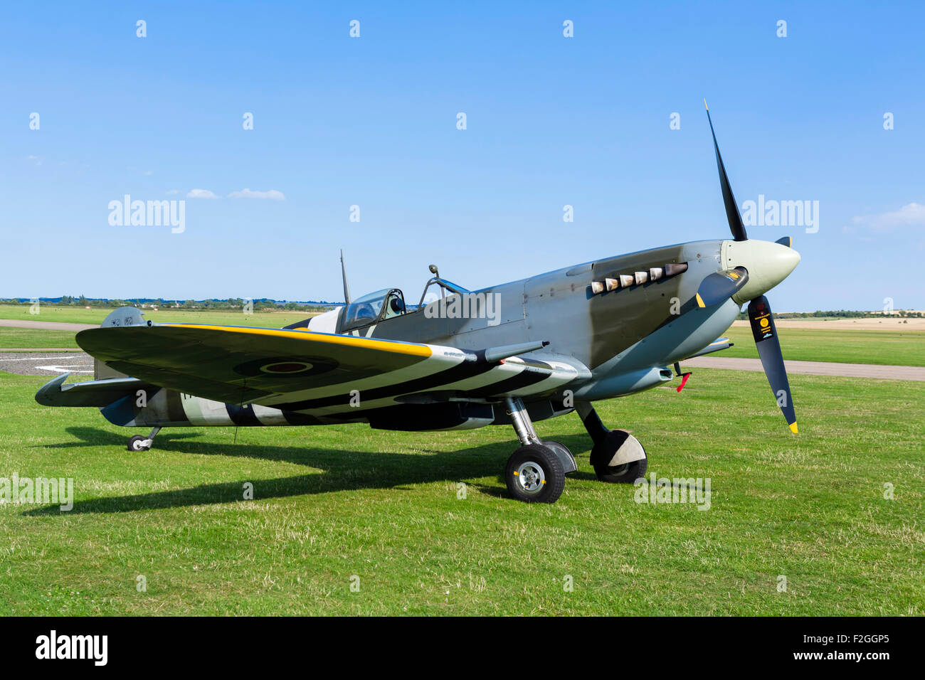 Supermarine Spitfire on the airfield at the Imperial War Museum, Duxford, Cambridgeshire, England, UK - Stock Image