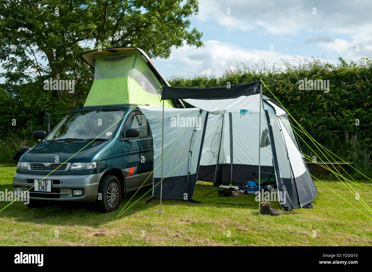 A Mazda Bongo campervan with side awning on a camp site near Sneaton
