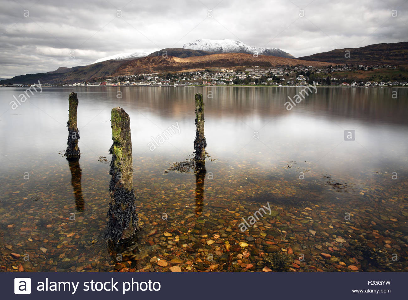 Ben Nevis and Fort William reflecting on Loch Linnhe from Trislaig. Stock Photo